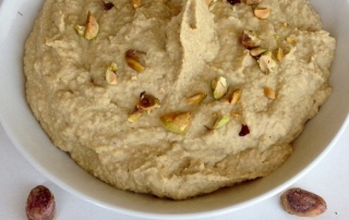 hummus with roasted pistachios by .